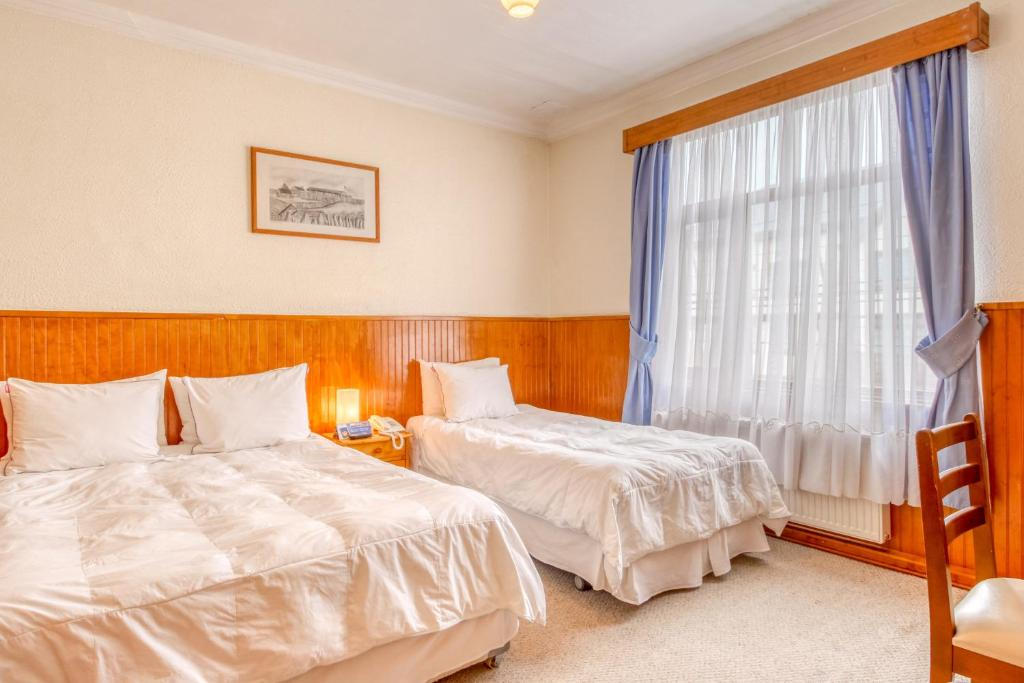Cama o camas de una habitación en Hotel Chalet Chapital