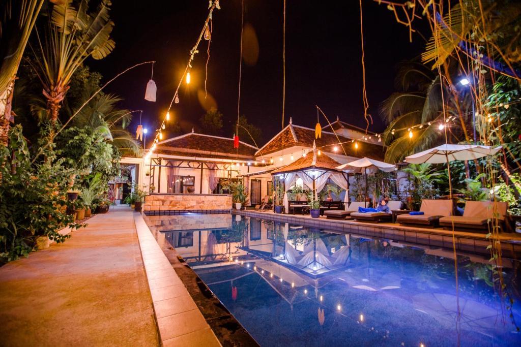 The swimming pool at or near The Sanctuary Villa Battambang