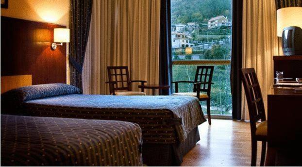 Cama o camas de una habitación en Lobios Caldaria Hotel Balneario