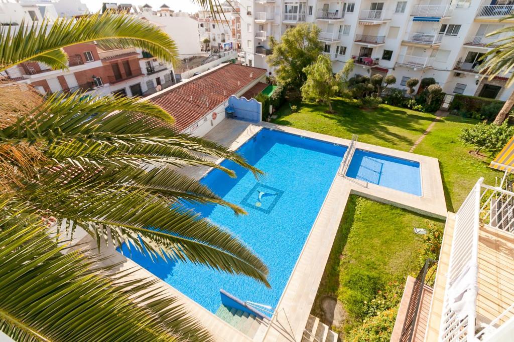 A view of the pool at Coronado Parador Nerja Canovas or nearby