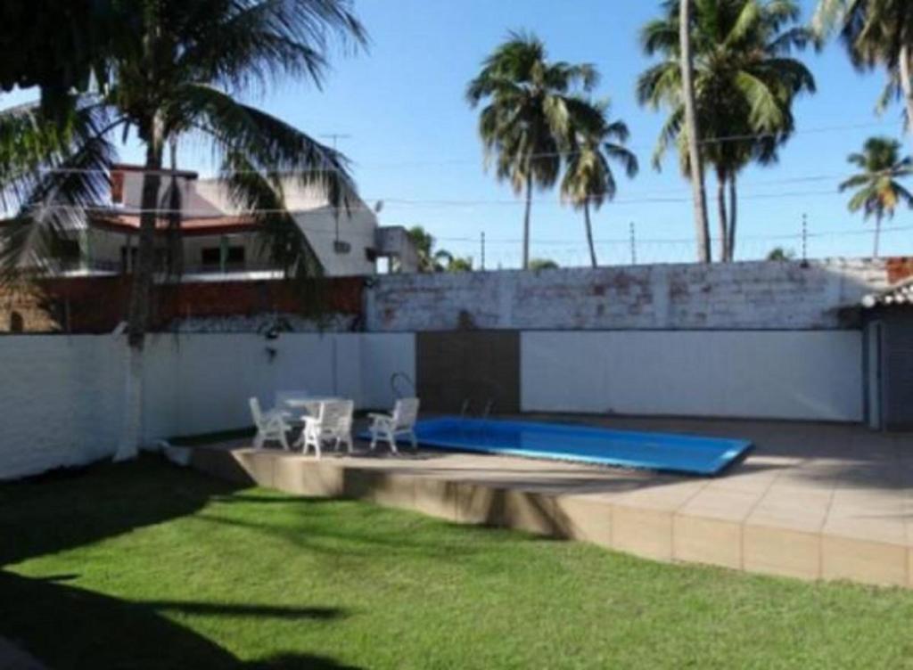 The swimming pool at or close to Casa Praia do Niquin Barra de São Miguel