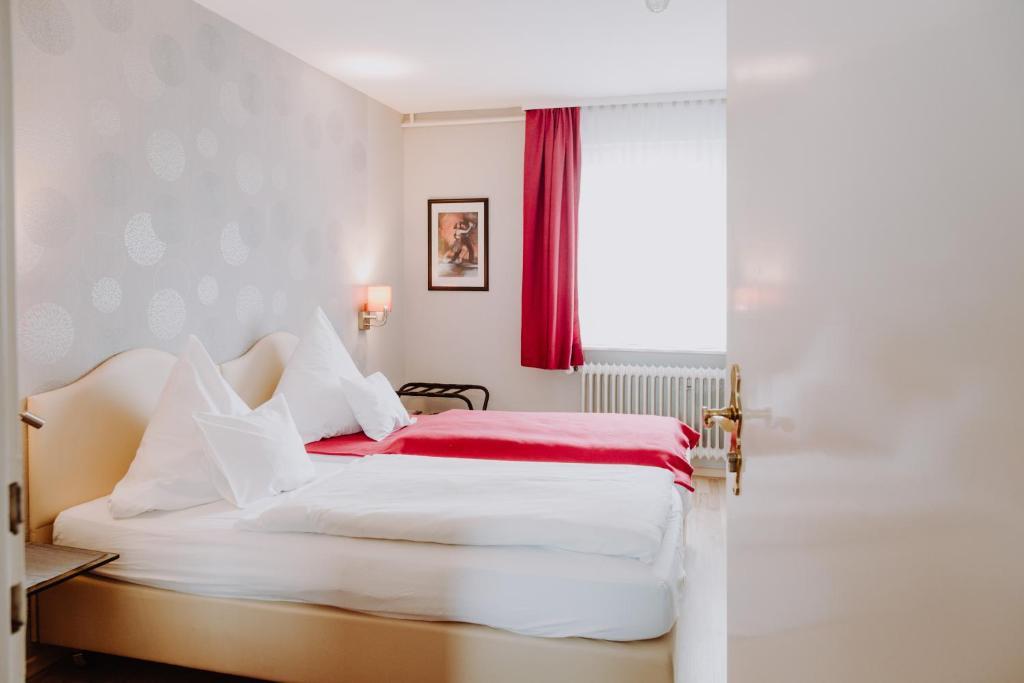 Ein Bett oder Betten in einem Zimmer der Unterkunft Hotel Moorbadstuben