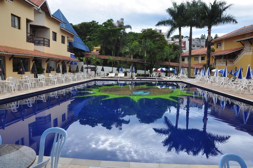 A piscina localizada em Resort Recanto do Teixeira All Inclusive ou nos arredores