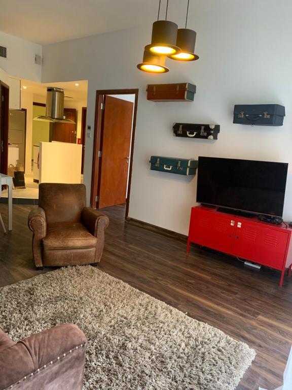 Снять квартиру в мотор сити дубай купить недвижимость Абу Даби Asimah