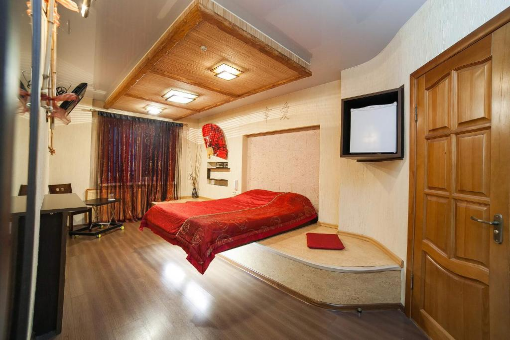 Кровать или кровати в номере Гостиница Даниловская