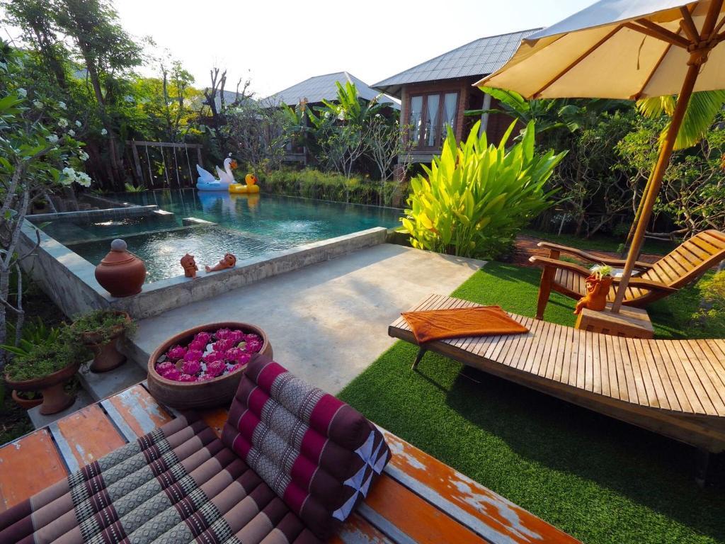 The swimming pool at or near BaanSuk Sukhothai Resort
