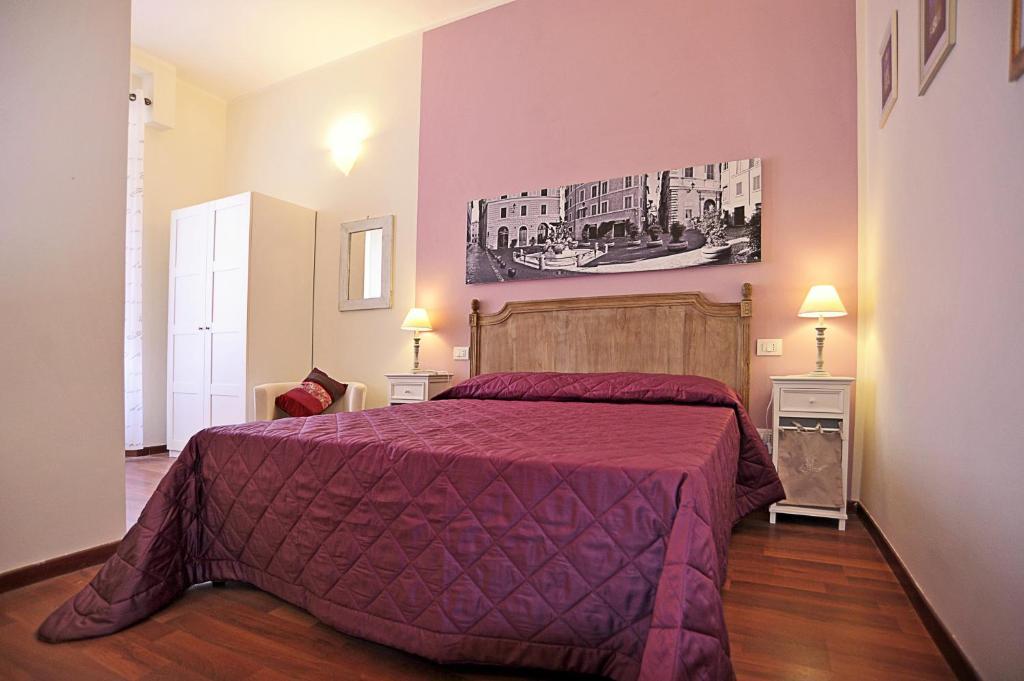 Un ou plusieurs lits dans un hébergement de l'établissement Piazzetta al Vaticano B&B