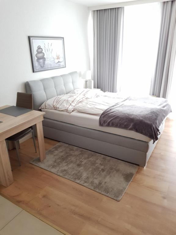 A bed or beds in a room at Apartment Nr 2 in Stuttgart Stadtmitte