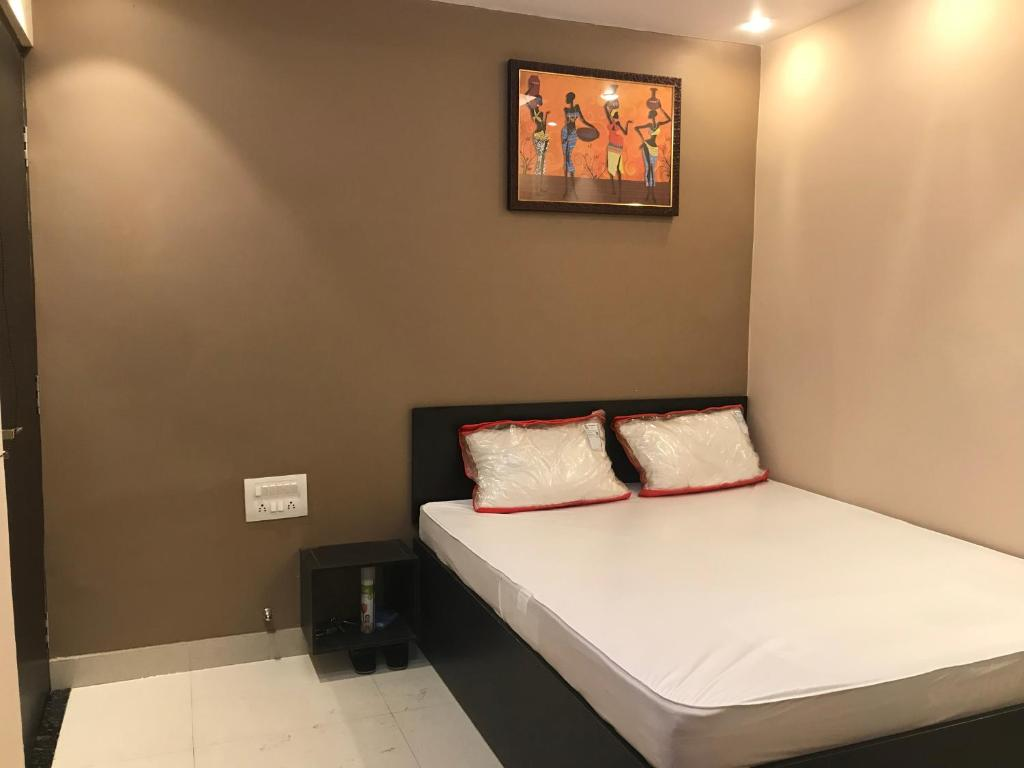 A bed or beds in a room at OM Guest House