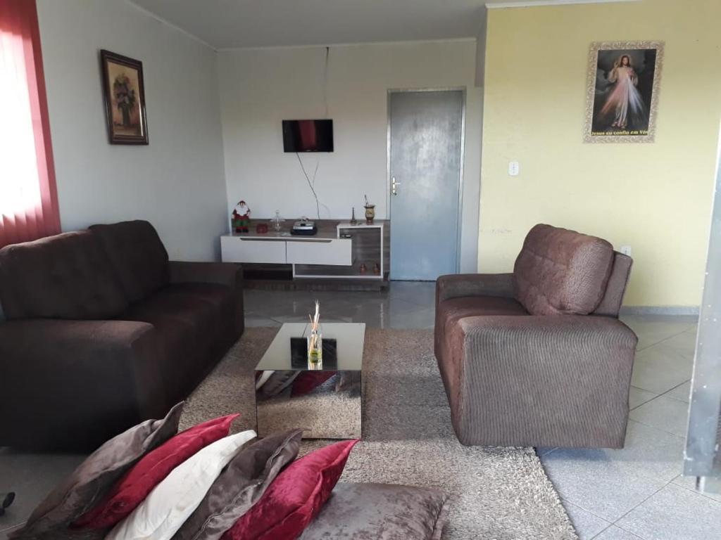 A seating area at Maria Bonita Casa de Temporada