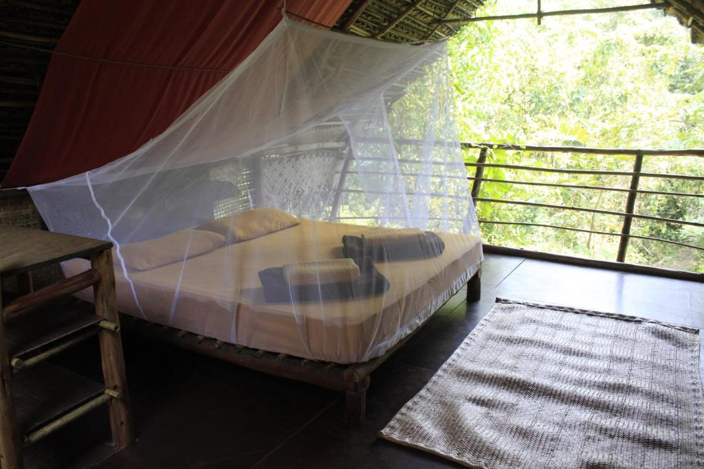 A bed or beds in a room at The Tribe Goa