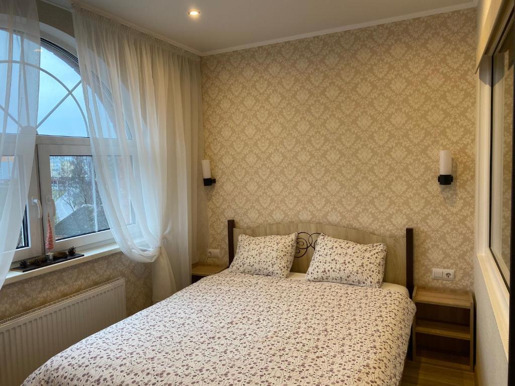 A bed or beds in a room at Аpartments in the center of Svetlogorsk-2