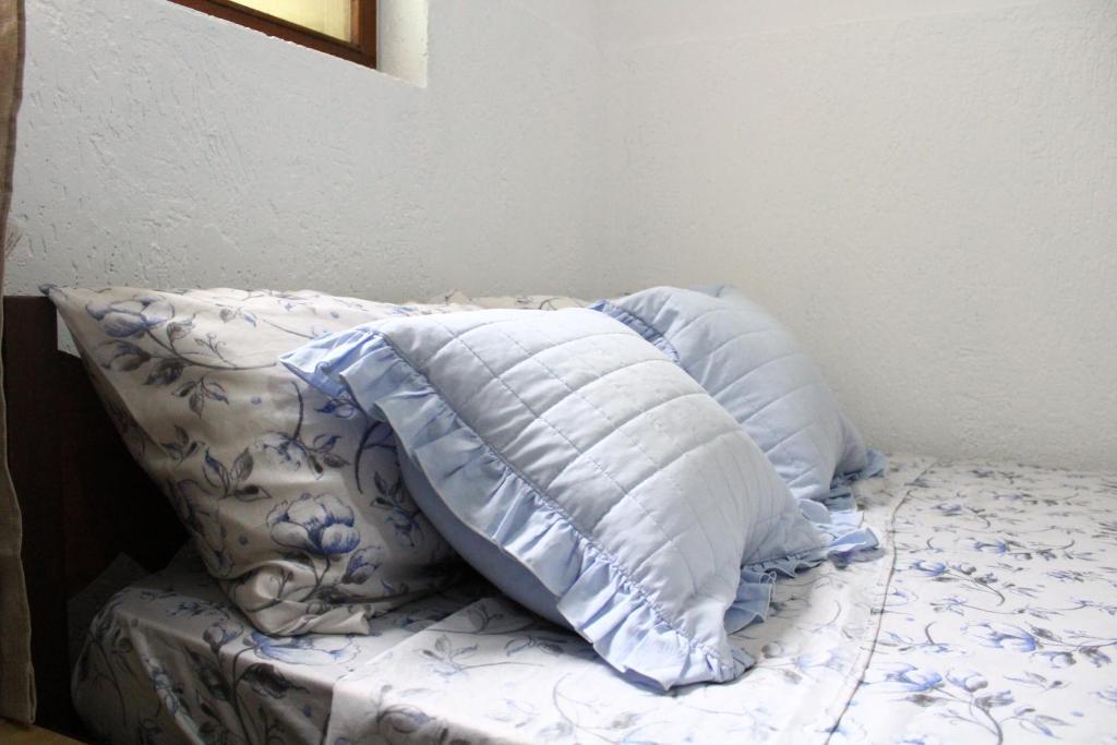 Cama ou camas em um quarto em Baú Pousada