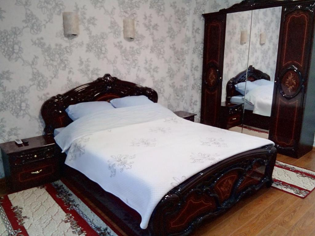 A bed or beds in a room at Апартаменты У рощи пицундских сосен