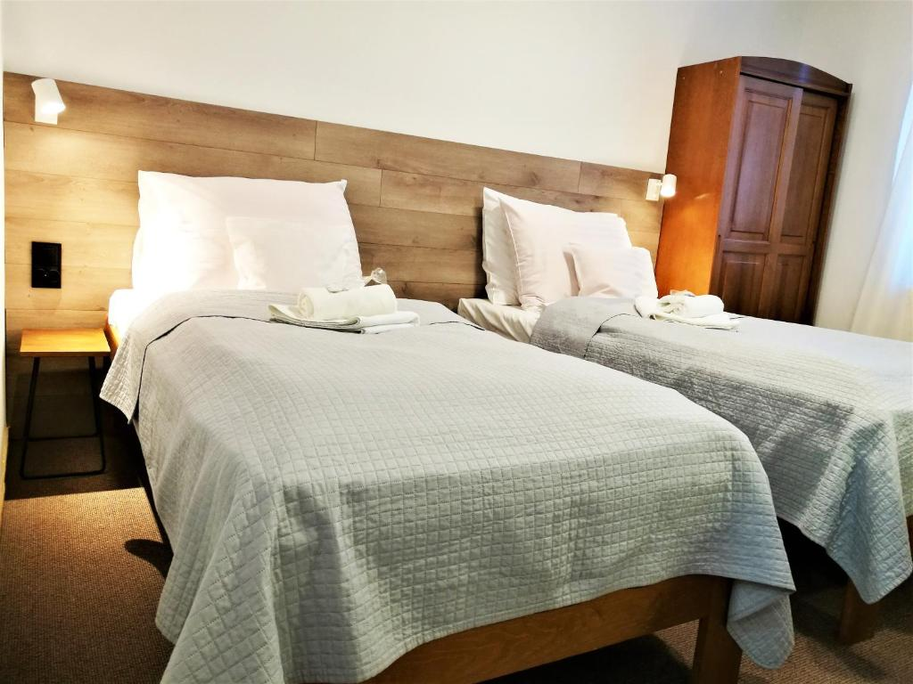 A bed or beds in a room at Hotel Protea