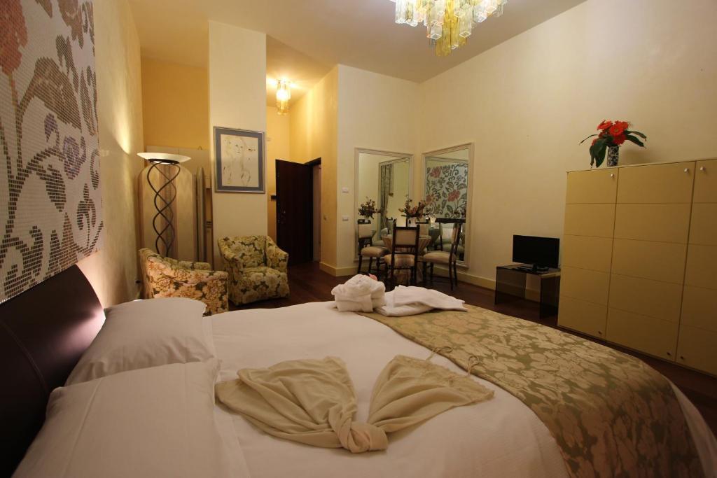 Letto o letti in una camera di B&B Pretoria Suite