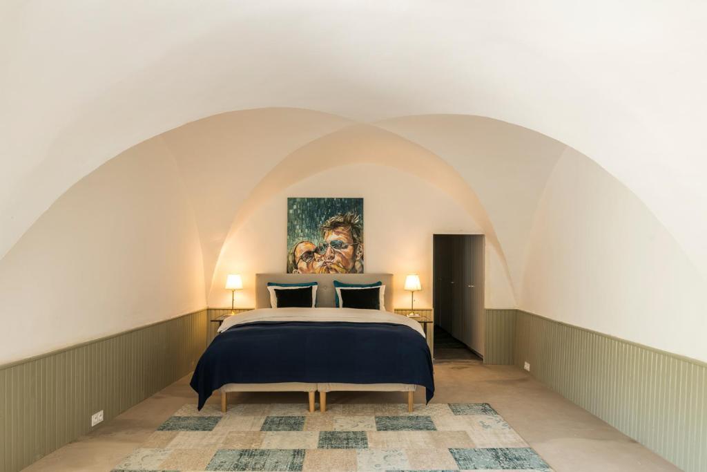 Een bed of bedden in een kamer bij Ecole Olargues