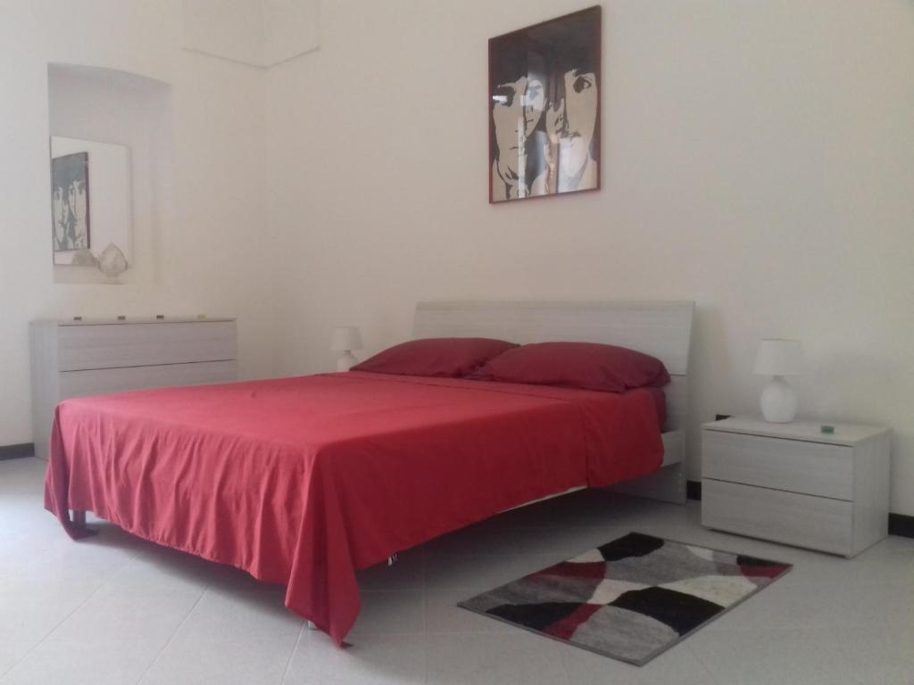Letto o letti in una camera di HAPPY HOUSE Salento Apartment