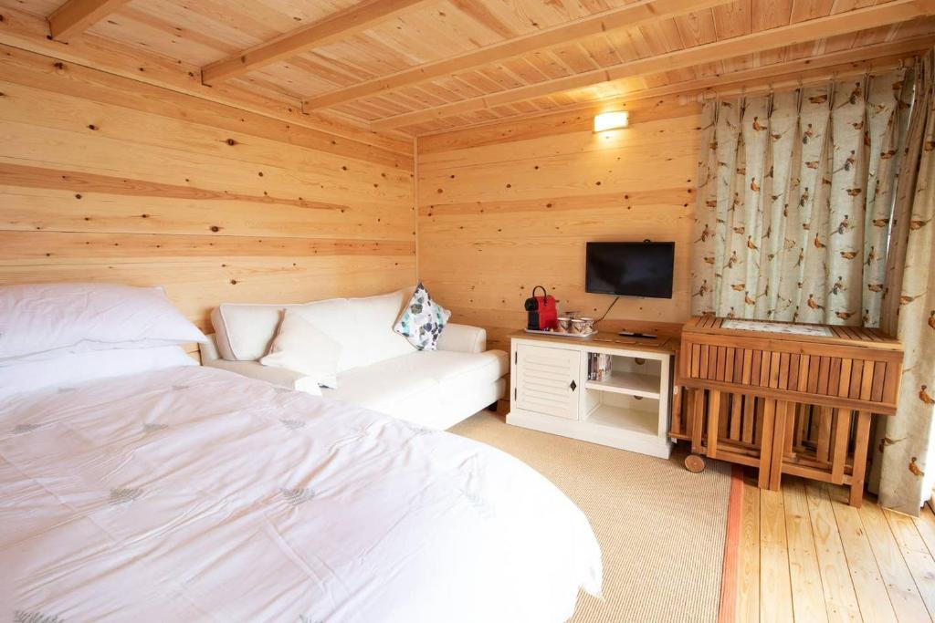 A bed or beds in a room at Moors Wood HotTub Retreat