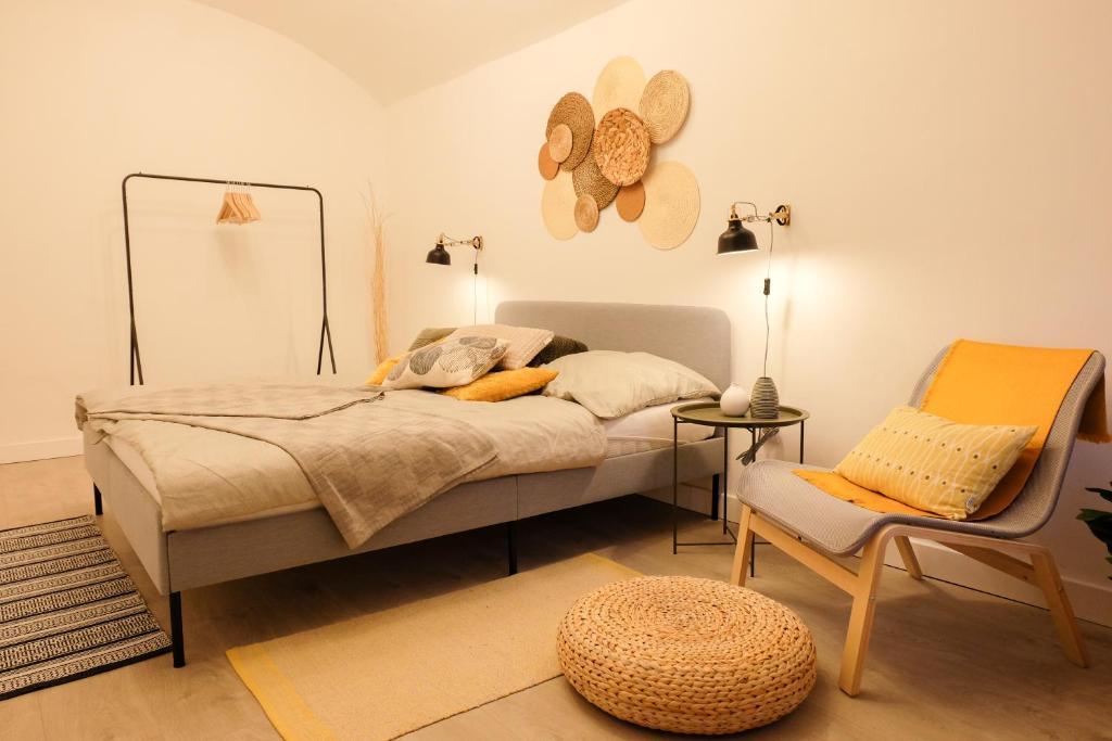 Posteľ alebo postele v izbe v ubytovaní STUDIO ELA Centre
