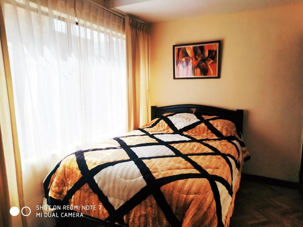 A bed or beds in a room at Confortable 2