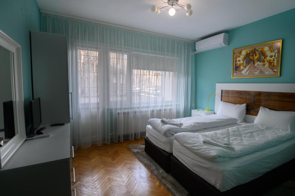 A bed or beds in a room at Апартамент за гости Римски терми