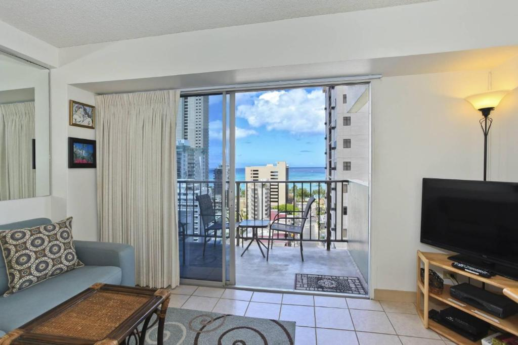A television and/or entertainment center at Waikiki Park Heights #1511
