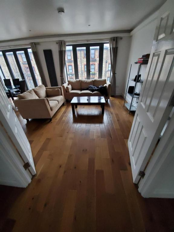 A seating area at Stylish deluxe 2 bedroom apartment in camberwell