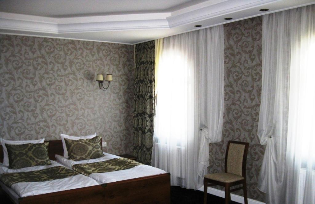 A bed or beds in a room at Kera Hotel