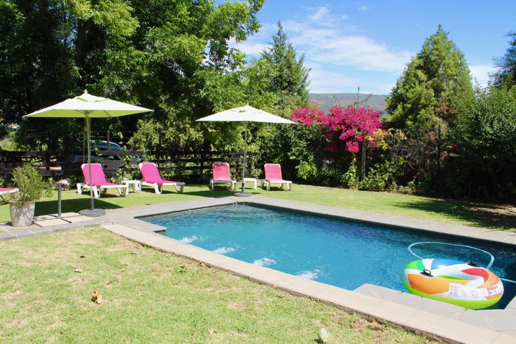 The swimming pool at or near Nuwerus Lodge Paarl