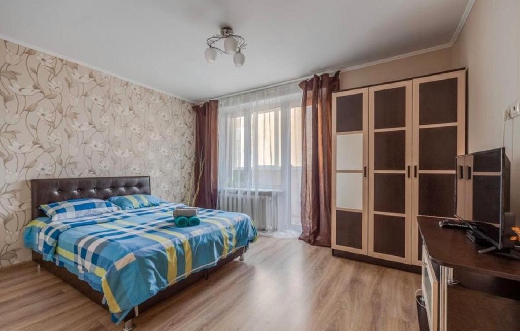 A bed or beds in a room at Апартаменты на 6-й Монетчиковский пер., 5