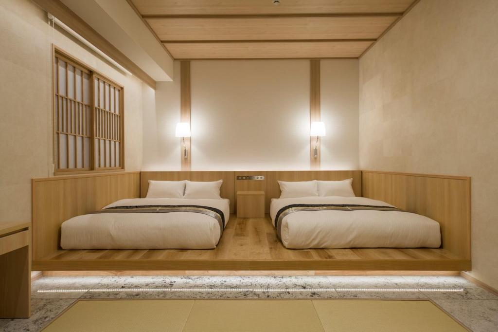 A bed or beds in a room at IAM HOTEL