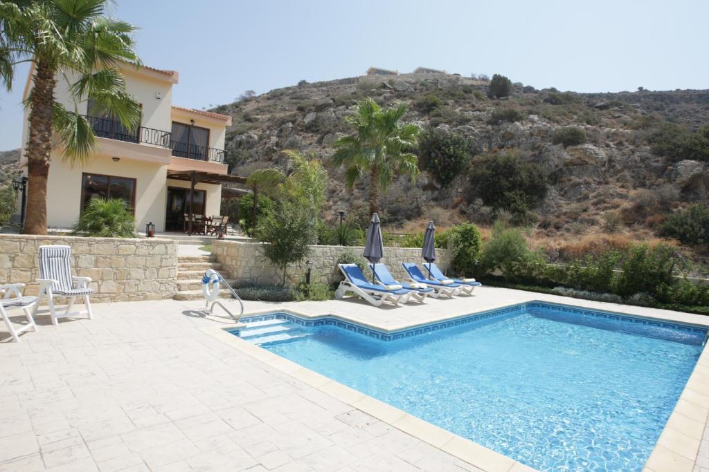 The swimming pool at or near Holidays Villas