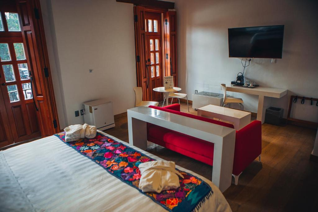A bed or beds in a room at Domingo Santo Hotel Boutique