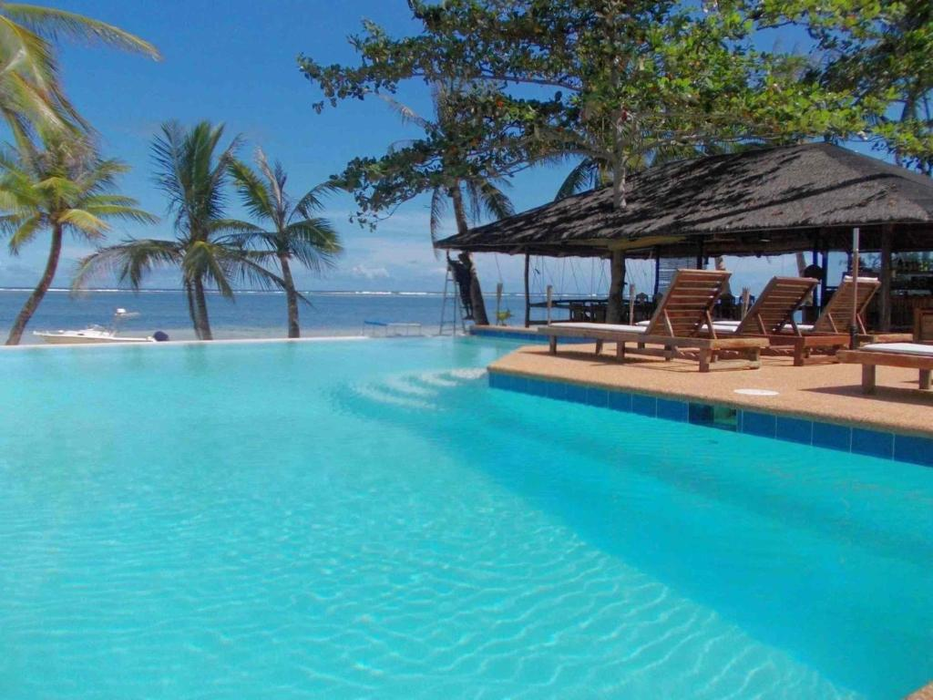The swimming pool at or near Romantic Beach Villas
