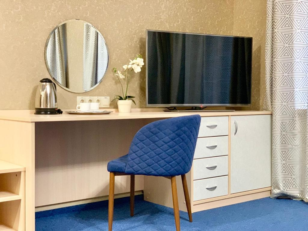 A television and/or entertainment center at Business Hotel Kostroma