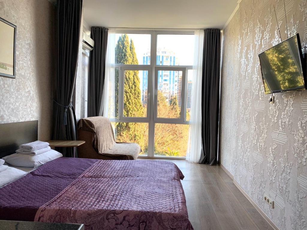 Кровать или кровати в номере Pansionat Svetlana