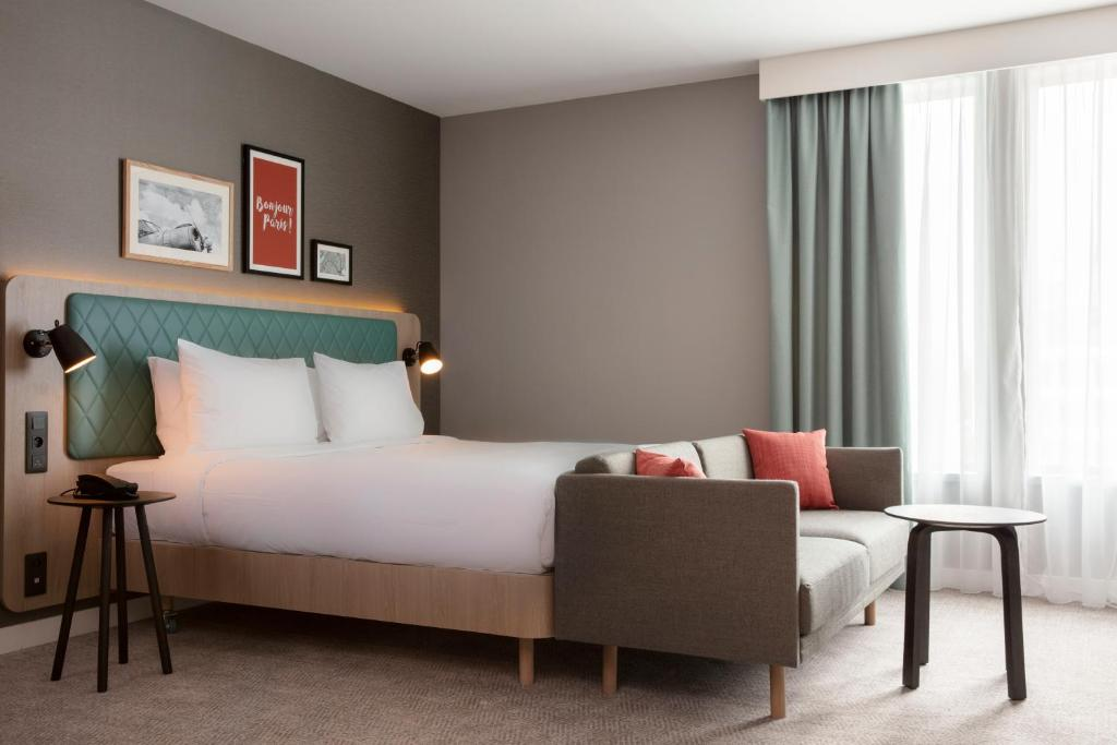 A bed or beds in a room at Hilton Garden Inn Paris Orly Airport