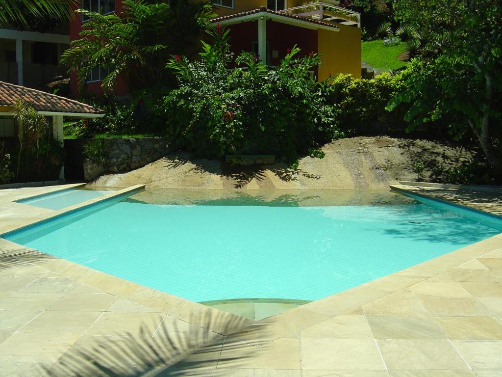 The swimming pool at or near Flat Angra Paradise