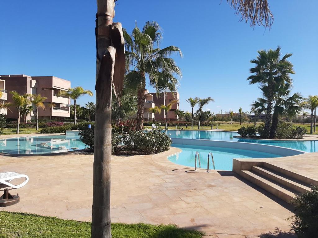 The swimming pool at or near Prestigia appartement opale