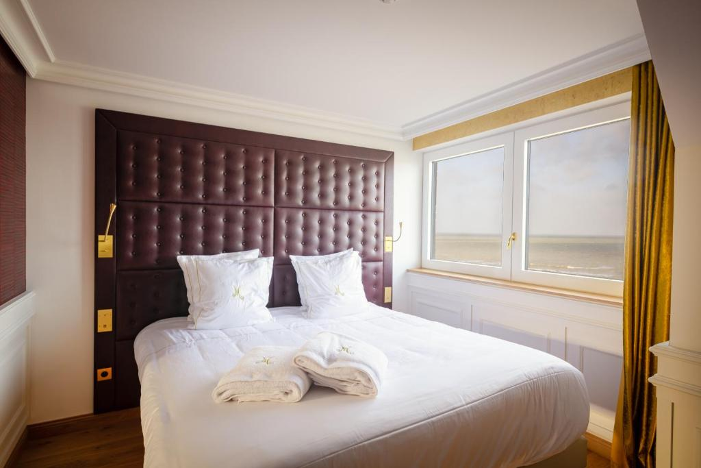 Un ou plusieurs lits dans un hébergement de l'établissement Hôtel Merveilleux Côté Mer