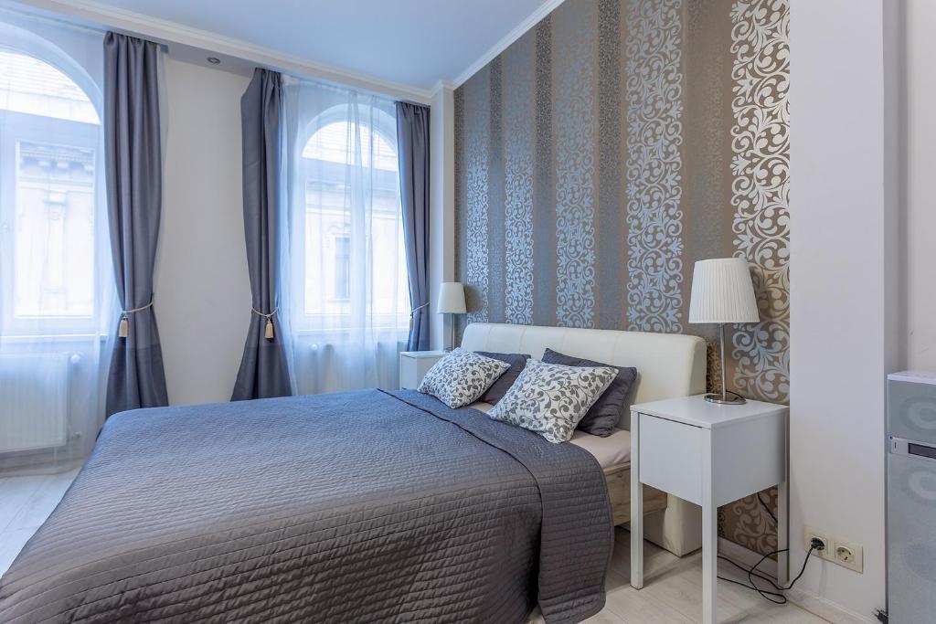 Кровать или кровати в номере Goldcentral Apartment Grand Boulevard