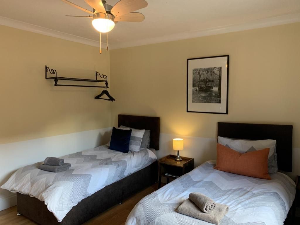 A bed or beds in a room at Southernwood - West Wing Room 2