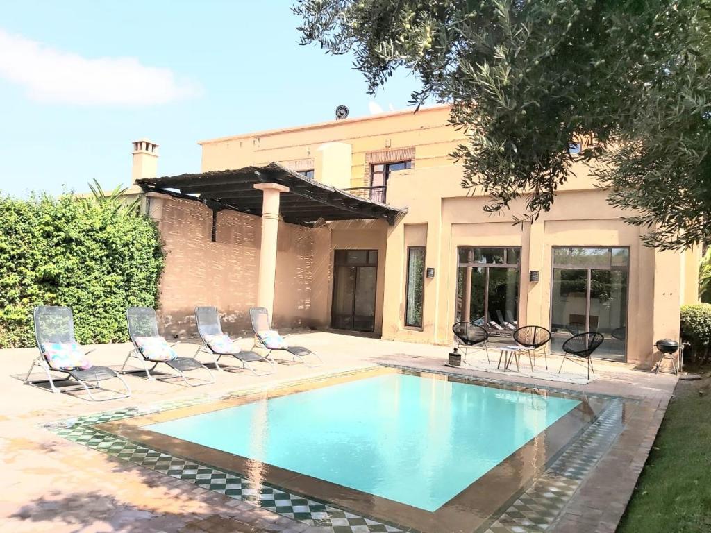 The swimming pool at or near La merveilleuse Dar Dounia