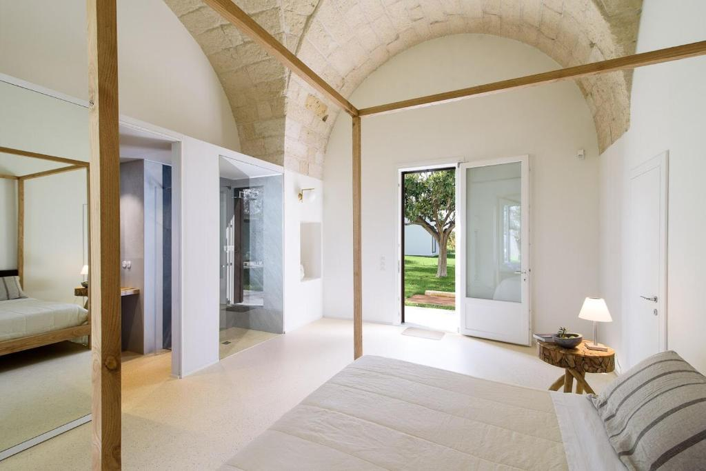 A bed or beds in a room at Masseria Mo'