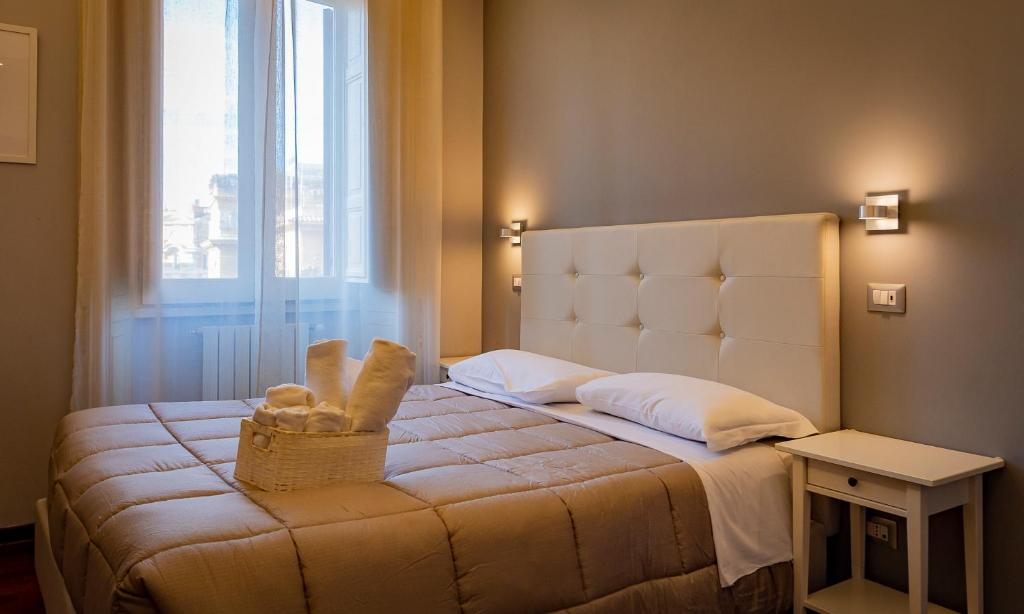 A bed or beds in a room at Borghese Executive Suite