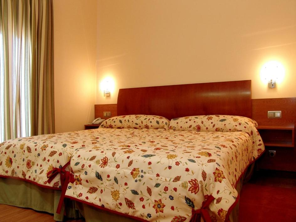 A bed or beds in a room at Complejo El Carrascal