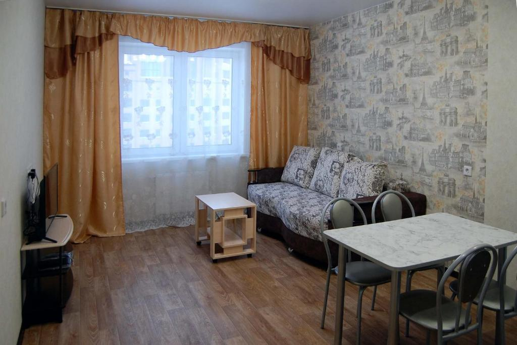 A seating area at Apartment Bulvar Molodezhi 46