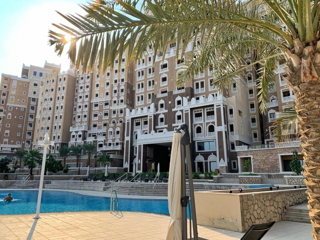 The swimming pool at or near Luxury Apartments at Balqis Residence