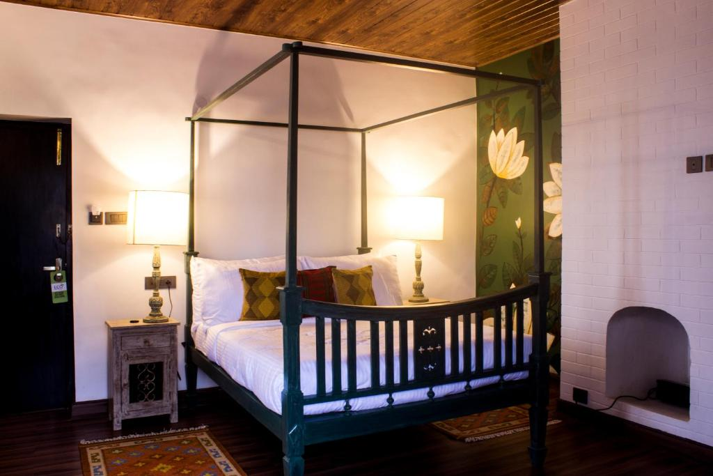A bed or beds in a room at The Temi Bungalow South Sikkim